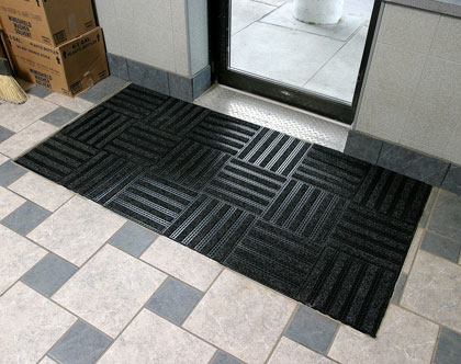 photo of linear look matting tiles at an entrance